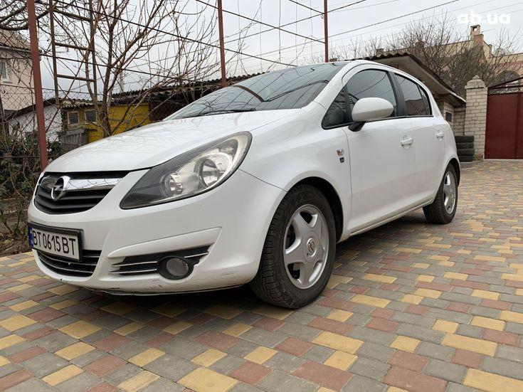 Opel Corsa 2010 белый - фото 1