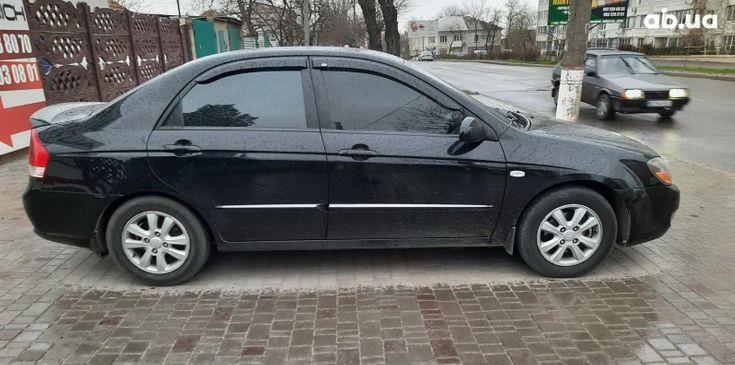 Kia Cerato 2007 черный - фото 4