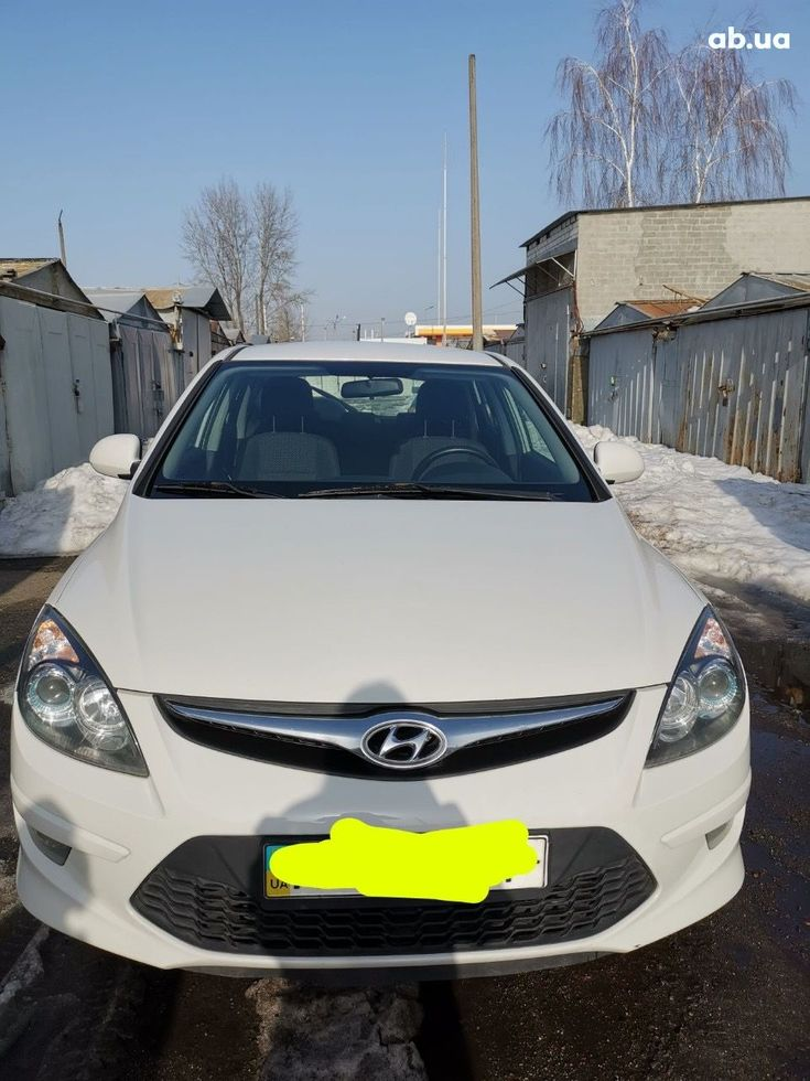 Hyundai i30 2011 белый - фото 8