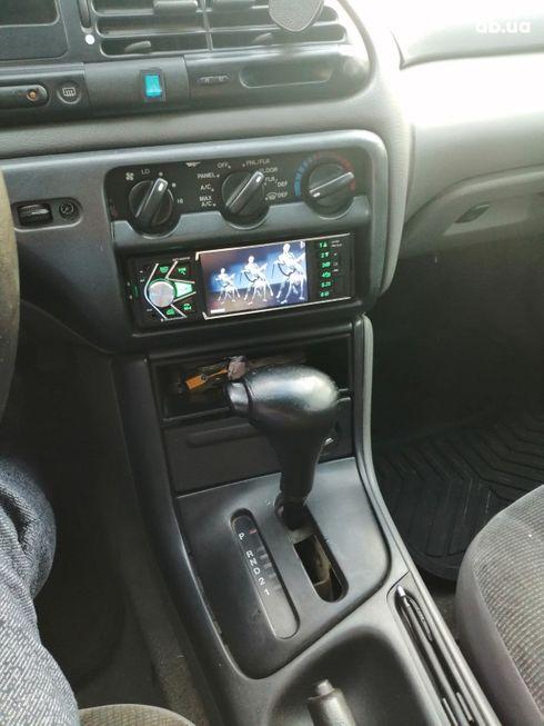 Ford Contour 1996 коричневый - фото 7