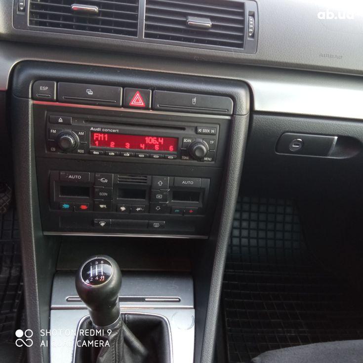 Audi A4 2004 черный - фото 9