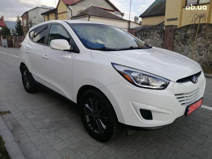 Hyundai Tucson 2015 белый - фото 1