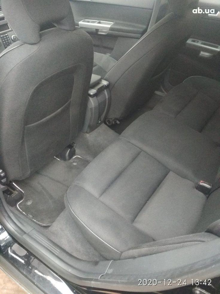 Volvo V50 2009 черный - фото 18