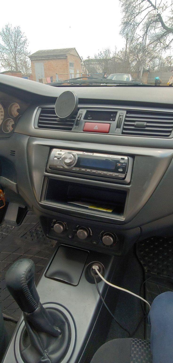 Mitsubishi Lancer 2005 серый - фото 3