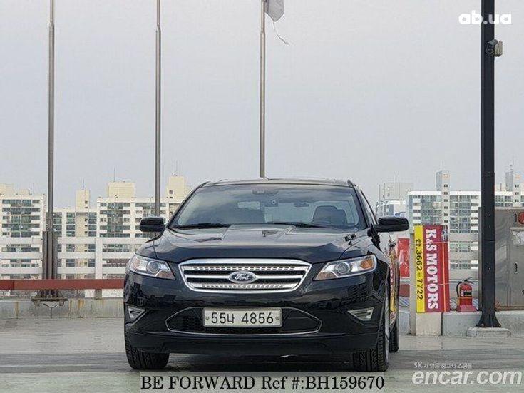 Ford Taurus 2012 черный - фото 1