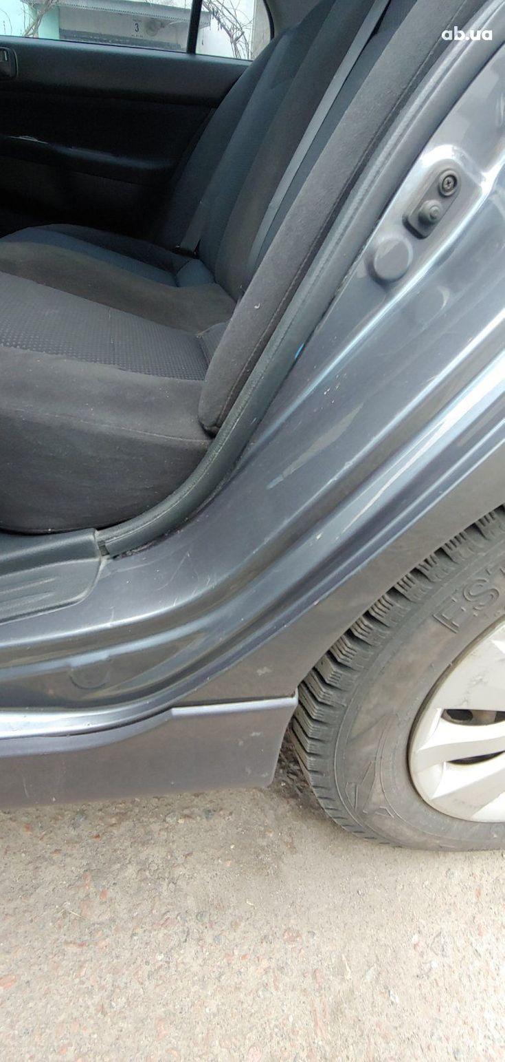 Mitsubishi Lancer 2005 серый - фото 15
