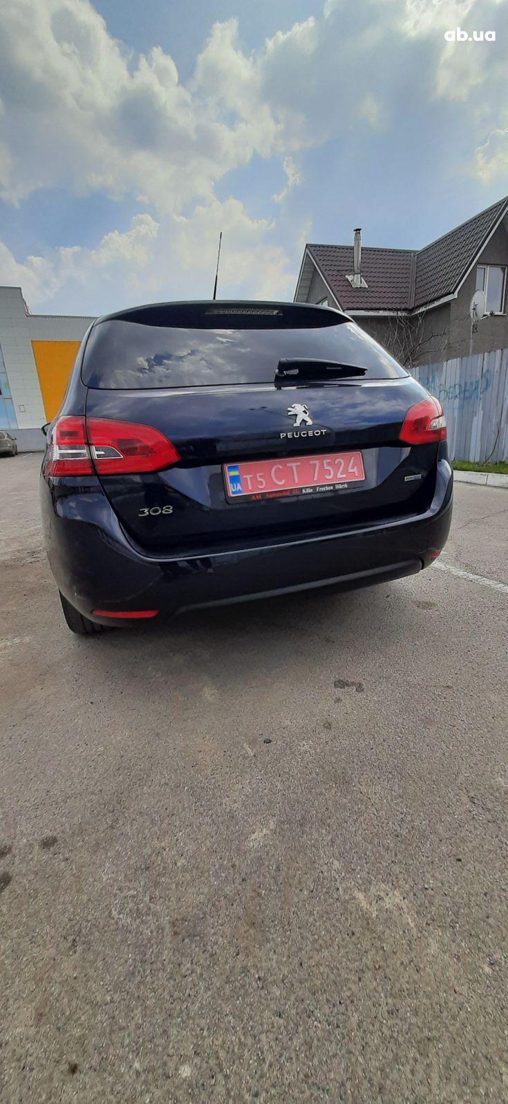 Peugeot 308 2015 синий - фото 6