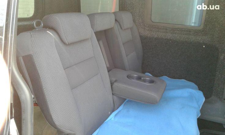 Volkswagen Caddy 2011 черный - фото 4