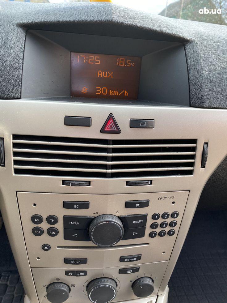 Opel Astra 2008 бежевый - фото 16