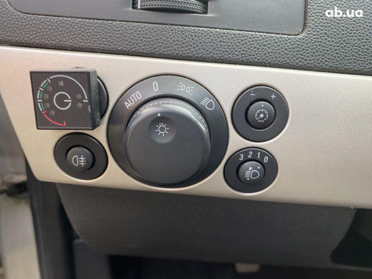 Opel Astra 2008 бежевый - фото 15